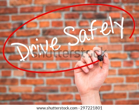 Man Hand writing  Drive Safely with black marker on visual screen. Isolated on bricks. Business, technology, internet concept. Stock Photo - stock photo