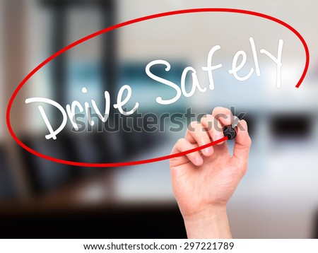 Man Hand writing  Drive Safely with black marker on visual screen. Isolated on office. Business, technology, internet concept. Stock Photo - stock photo