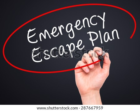 Man Hand writing Emergency Escape Plan with black marker on visual screen. Isolated on black. Business, technology, internet concept. Stock Image - stock photo
