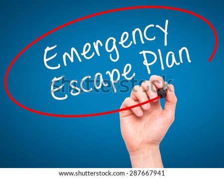 Man Hand writing Emergency Escape Plan with black marker on visual screen. Isolated on blue. Business, technology, internet concept. Stock Image - stock photo