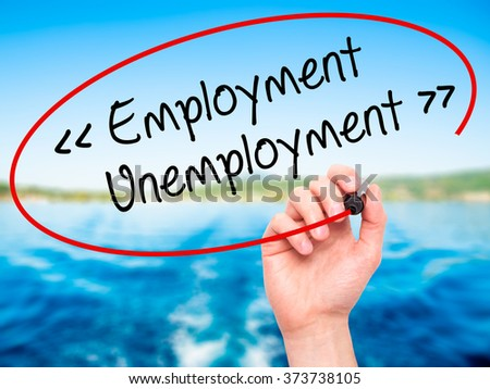 Man Hand writing Employment - Unemployment with black marker on visual screen. Isolated on background. Business, technology, internet concept. Stock Photo - stock photo