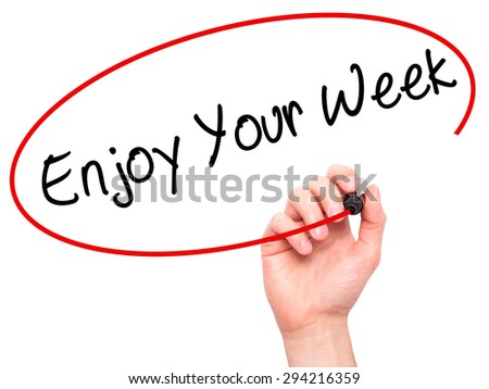 Man Hand writing Enjoy Your Week with black marker on visual screen. Isolated on white. Business, technology, internet concept. Stock Photo - stock photo