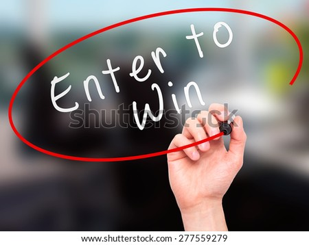 Man Hand writing Enter to Win with marker on transparent wipe board. Isolated on office. Business, internet, technology concept.  Stock Photo - stock photo