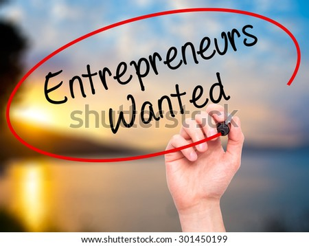 Man Hand writing Entrepreneurs Wanted with black marker on visual screen. Isolated on nature. Business, technology, internet concept. Stock Photo - stock photo