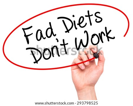Man Hand writing Fad Diets Don't Work with black marker on visual screen. Isolated on white. Business, technology, internet concept. Stock Photo - stock photo