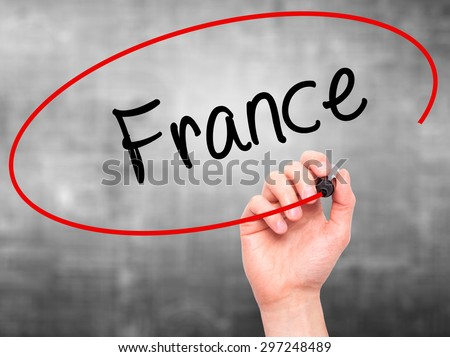 Man Hand writing France with black marker on visual screen. Isolated on grey. Business, technology, internet concept. Stock Photo