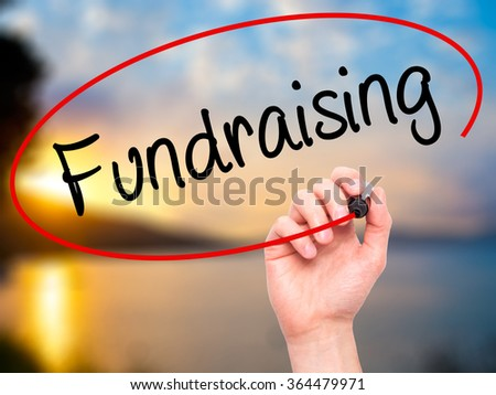 Man Hand writing Fundraising with black marker on visual screen. Isolated on background. Business, technology, internet concept. Stock Photo - stock photo