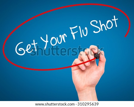Man Hand writing Get Your Flu Shot with black marker on visual screen. Isolated on blue. Business, technology, internet concept. Stock Photo - stock photo