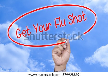 Man Hand writing Get Your Flu Shot with black marker on visual screen. Isolated on white. Business, technology, internet concept. Stock Photo - stock photo