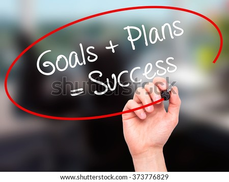 Man Hand writing Goals + Plans = Success with black marker on visual screen. Isolated on background. Business, technology, internet concept. Stock Photo - stock photo