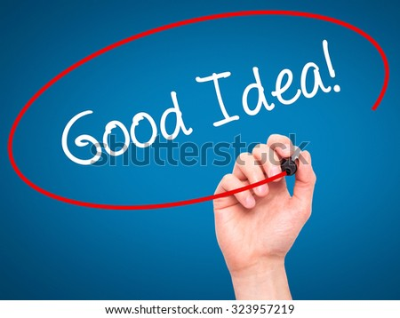 Man Hand writing Good Idea! with black marker on visual screen. Isolated on blue. Business, technology, internet concept. Stock Photo - stock photo