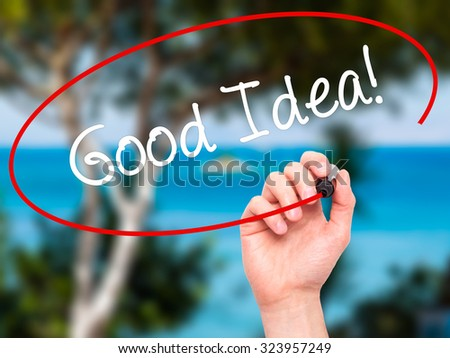 Man Hand writing Good Idea! with black marker on visual screen. Isolated on nature. Business, technology, internet concept. Stock Photo - stock photo