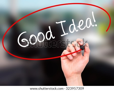 Man Hand writing Good Idea! with black marker on visual screen. Isolated on office. Business, technology, internet concept. Stock Photo - stock photo
