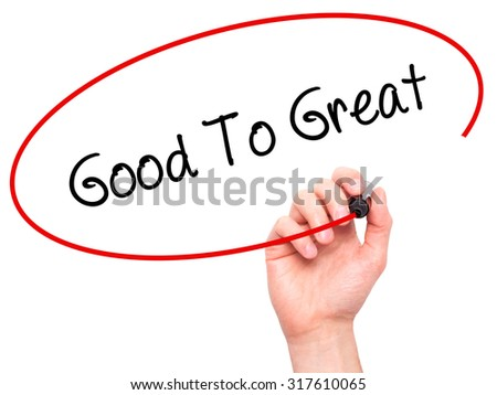 Man Hand writing Good To Great with black marker on visual screen. Isolated on white. Business, technology, internet concept. - stock photo