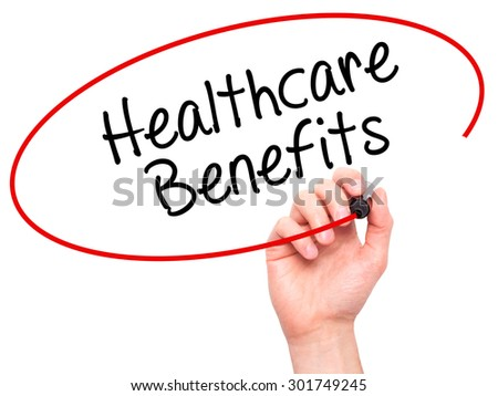 Man Hand writing Healthcare Benefits with black marker on visual screen. Isolated on white. Business, technology, internet concept. Stock Photo - stock photo