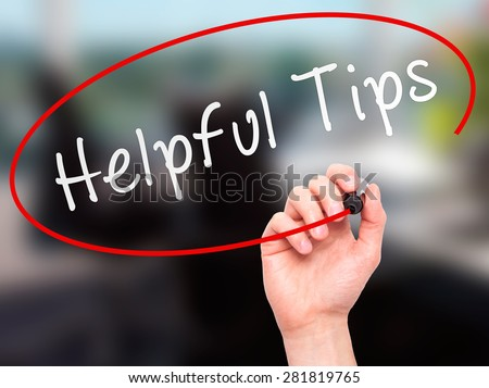 Man hand writing Helpful Tips on visual screen. Business,help, internet, technology concept. Isolated on office. Stock Photo - stock photo