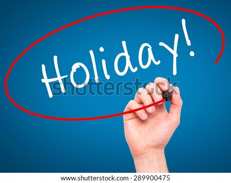Man Hand writing Holiday! with black marker on visual screen. Isolated on blue. Business, technology, internet concept. Stock Image - stock photo