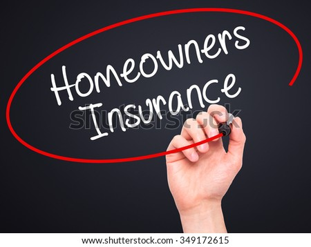 Man Hand writing Homeowners Insurance with black marker on visual screen. Isolated on background. Business, technology, internet concept. Stock Photo