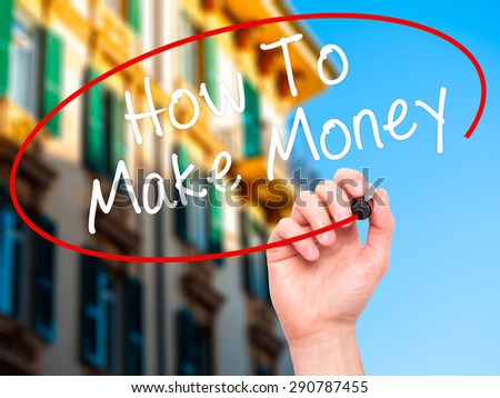 Man Hand writing How To Make Money with black marker on visual screen. Isolated on city. Business, technology, internet concept. Stock Image - stock photo