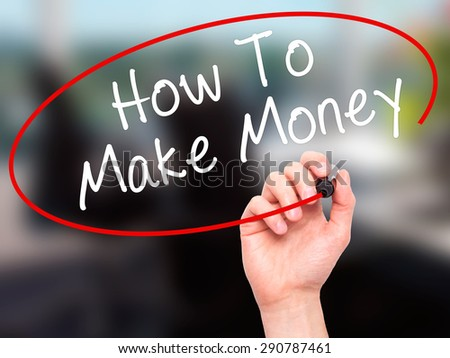 Man Hand writing How To Make Money with black marker on visual screen. Isolated on office. Business, technology, internet concept. Stock Image - stock photo
