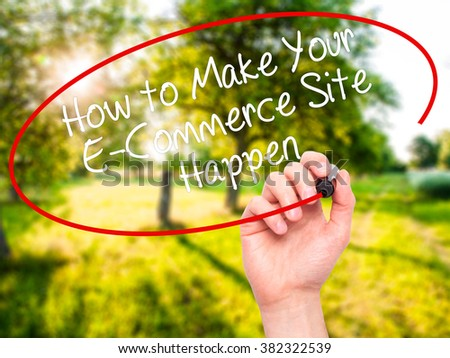 Man Hand writing How to Make Your E-Commerce Site Happen with black marker on visual screen. Isolated on background. Business, technology, internet concept. Stock Photo - stock photo