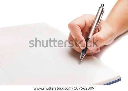 Man hand writing in open book isolated on white background