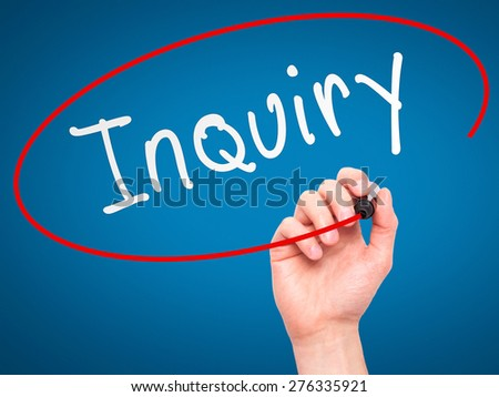 Man Hand writing Inquiry with marker on transparent wipe board. Isolated on blue. Business, internet, technology concept.  Stock Photo - stock photo