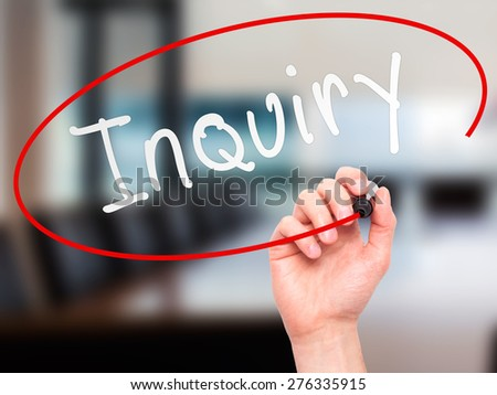 Man Hand writing Inquiry with marker on transparent wipe board. Isolated on office. Business, internet, technology concept.  Stock Photo - stock photo