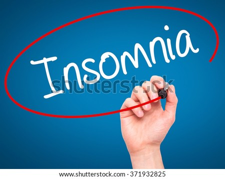 Man Hand writing Insomnia  with black marker on visual screen. Isolated on background. Business, technology, internet concept. Stock Photo - stock photo