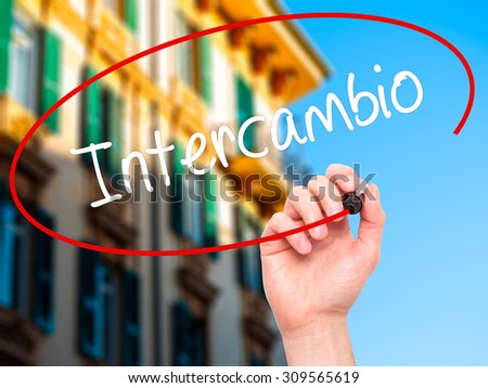 "Man Hand writing ""Intercambio"" (In portuguese - Student Exchange Program)  with black marker on visual screen. Isolated on city. Business, technology, internet concept. Stock Photo - stock photo"