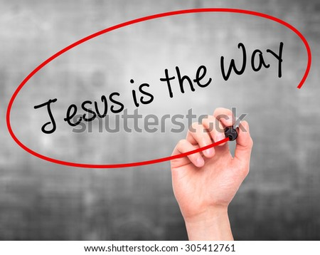 Man Hand writing Jesus is the Way with black marker on visual screen. Isolated on grey. Business, technology, internet concept. Stock Photo - stock photo