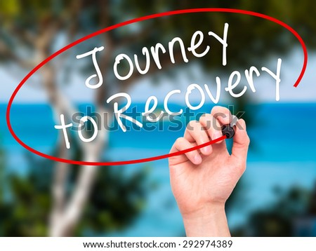 Man Hand writing Journey to Recovery with black marker on visual screen. Isolated on nature. Life, technology, internet concept. Stock Image - stock photo