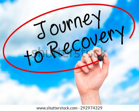 Man Hand writing Journey to Recovery with black marker on visual screen. Isolated on sky. Life, technology, internet concept. Stock Image - stock photo