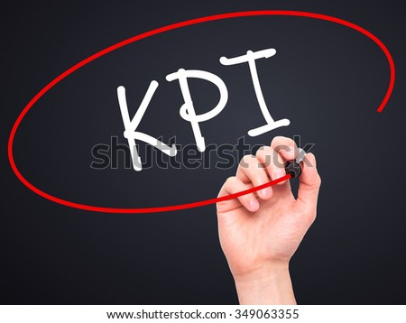 Man Hand writing KPI (Key Performance Indicator) with black marker on visual screen. Isolated on background. Business, technology, internet concept. Stock Photo