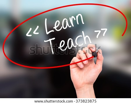 Man Hand writing Learn - Teach with black marker on visual screen. Isolated on background. Business, technology, internet concept. Stock Photo