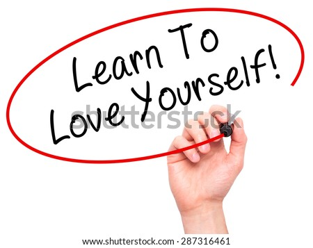 Man Hand writing Learn To Love Yourself with marker on transparent wipe board. Isolated on white. Business, internet, technology concept. Stock Photo - stock photo