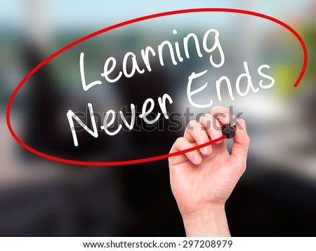 Man Hand writing Learning Never Ends with black marker on visual screen. Isolated on offce. Business, technology, internet concept. Stock Photo - stock photo