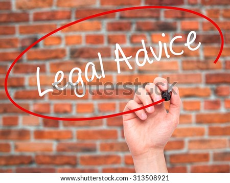 Man Hand writing Legal Advice with black marker on visual screen. Isolated on bricks. Business, technology, internet concept. Stock Photo - stock photo