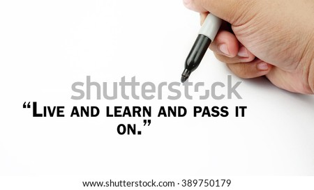 "Man Hand writing ""live and learn and pass it on"" with black marker on visual screen. Isolated white background. Business, technology, internet concept."