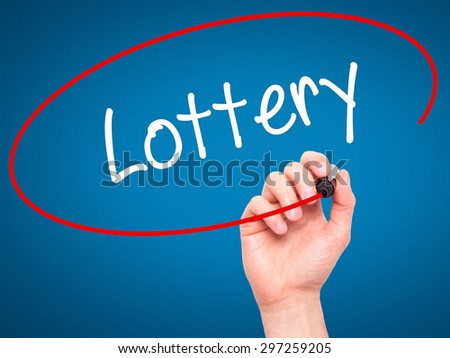 Man Hand writing Lottery  with black marker on visual screen. Isolated on blue. Business, technology, internet concept. Stock Photo - stock photo