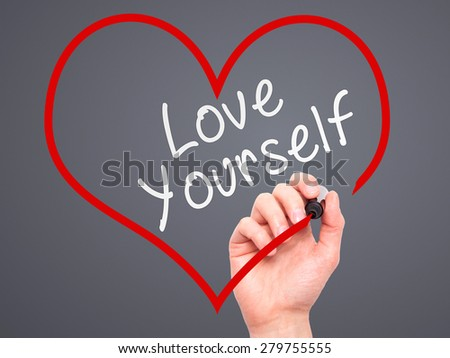 Man Hand writing Love Yourself with marker on transparent wipe board, inside heart shape. Isolated on grey. Business, internet, technology concept. Stock Photo - stock photo