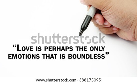 "Man Hand writing ""loves is perhaps the only emotions that is bounderless"" with black marker on visual screen. Isolated white background. Business, technology, internet concept. Stock Photo"
