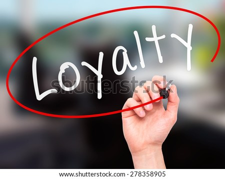 Man Hand writing Loyalty with marker on transparent wipe board. Isolated on office. Business, internet, technology concept.  Stock Photo - stock photo