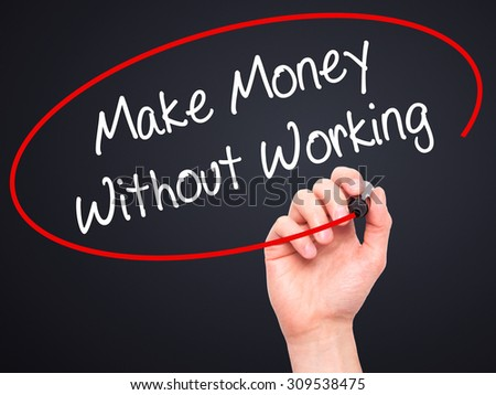 Man Hand writing Make Money Without Working with black marker on visual screen. Isolated on black. Business, technology, internet concept. Stock Photo