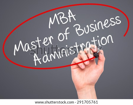 Man Hand writing MBA - Master of Business Administration with black marker on visual screen. Isolated on grey. Business, technology, internet concept. Stock Image