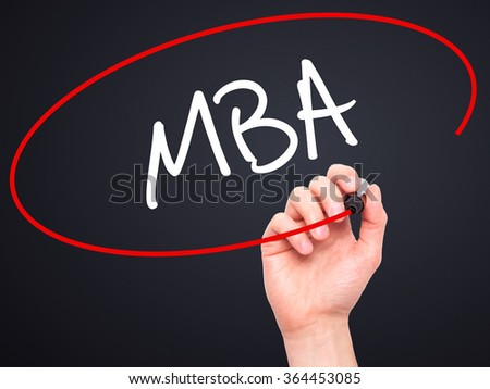 Man Hand writing MBA with black marker on visual screen. Isolated on background. Business, technology, internet concept. Stock Photo