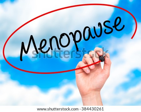 Man Hand writing Menopause with black marker on visual screen. Isolated on background. Business, technology, internet concept. Stock Photo - stock photo