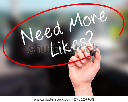 Man Hand writing Need More Likes? black marker on visual screen. Isolated on office. Business, technology, internet concept. Stock Image - stock photo