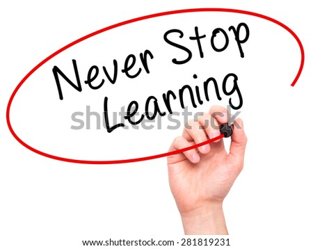 Man hand writing Never Stop Learning on visual screen. Business,help, internet, technology concept. Isolated on white. Stock Photo - stock photo