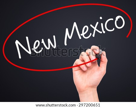 Man Hand writing New Mexico with black marker on visual screen. Isolated on black. Business, technology, internet concept. Stock Photo - stock photo